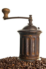 Vintage coffee grinder with coffee beans around it