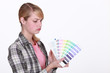 craftswoman painter holding a color chart