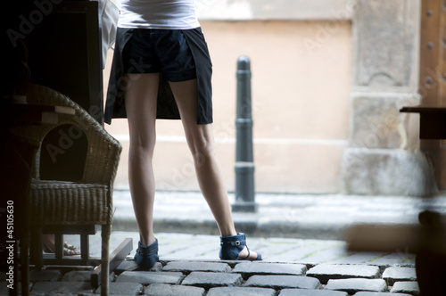 Low section of waitress standing in doorway