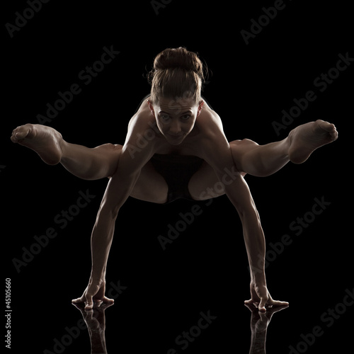 Studio shot of young woman practicing yoga