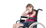 Very sad handicapped girl in a wheelchair over white background