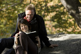 USA, New York City, Manhattan, Central Park, Mature couple reading book in Central Park