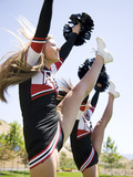 USA, Utah, American Fork, Cheerleaders doing high kick