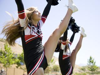 USA, Utah, American Fork, Cheerleaders doing high kick