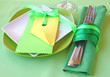 Decorative green serving table with clean guest card