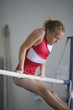 USA, Utah, Orem, girl (10-11) exercising on pole in gym