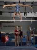 USA, Utah, Orem, girls (10-11) in gym watching friend exercising on pole
