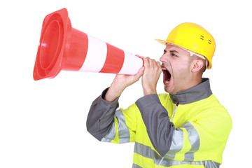 Traffic guard screaming into a pylon