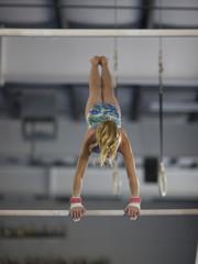 USA, Utah, Orem, girl (10-11) exercising on pole in gym