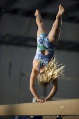 USA, Utah, Orem, girl (10-11) exercising on balance beam