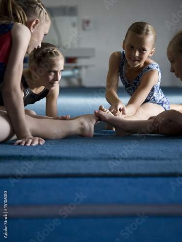 USA, Utah, Orem, Girls (8-11) stretching in gym