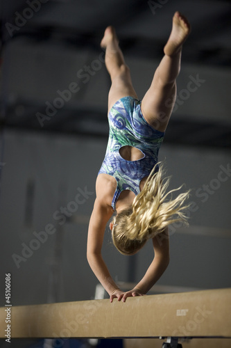 USA, Utah, Orem, girl (10-11) exercising on balance beam