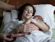 USA, Utah, Payson, Mother embracing newborn baby