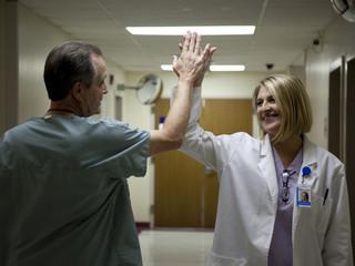 USA, Utah, Payson, Mature doctors making high five