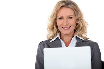Portrait of blonde woman with computer