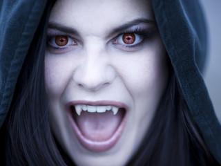 """USA, Utah, Cedar Hills, Portrait of female teenage vampire (16-17) wearing hood"""