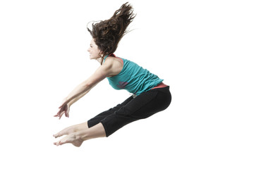 Woman jumping with arms outstretched