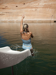"""USA, Utah, Woman splashing in Lake Powell"""