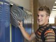 """USA, Utah, Spanish Fork, Portrait of school boy (16-17) taking file from locker"""