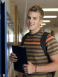 """USA, Utah, Spanish Fork, Portrait of school boy (16-17) holding file in corridor"""