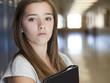 """""""USA, Utah, Spanish Fork, Portrait of school girl (16-17) holding file in corridor"""""""