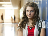 """USA, Utah, Portrait of teenage girl (14-15) in school corridor"""