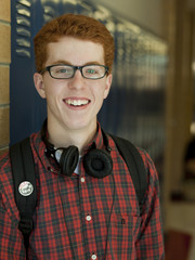 """USA, Utah, Portrait of teenage boy (16-17) in school corridor"""