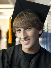 """USA, Utah, Spanish Fork, Portrait of male graduate student wearing mortar board"""