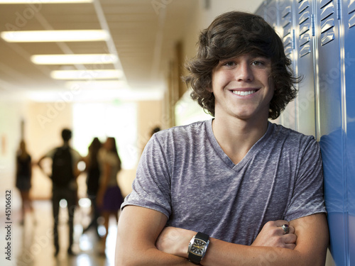 """USA, Utah, Portrait of young man in school corridor"""
