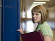 """""""USA, Utah, Spanish Fork, Portrait of school girl (16-17) holding file by locker"""""""