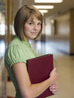 """USA, Utah, Spanish Fork, Portrait of school girl (16-17) holding file in corridor"""