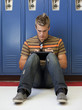 """USA, Utah, Spanish Fork, School boy (16-17) using digital tablet by lockers"""