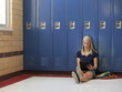 """USA, Utah, Spanish Fork, School girl (16-17) using digital tablet by lockers"""