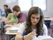 """USA, Utah, Spanish Fork, School girl (14-15) working in classroom"""