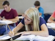 """USA, Utah, Spanish Fork, School girl (16-17) working in classroom"""