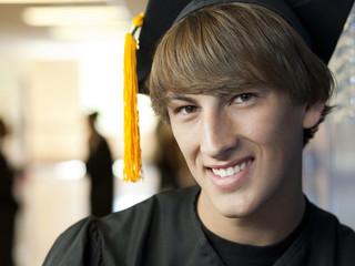 """USA, Utah, Spanish Fork, Portrait of male graduate student wearing mortar board"""