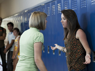 """USA, Utah, Spanish Fork, Two girls (16-17) arguing in school corridor"""