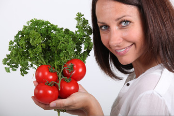 lady posing with tomatoes and parsley