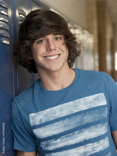 """USA, Utah, Spanish Fork, Portrait of school boy standing by lockers"""