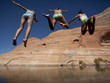 """USA, Utah, Lake Powell, Three women jumping into lake"""