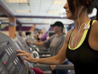 """USA, Utah, Draper, Woman exercising on treadmill"""