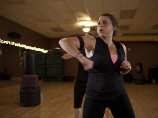 """""""USA, Utah, Draper, Woman exercising in gym"""""""