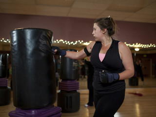 """USA, Utah, Draper, Woman boxing in gym"""