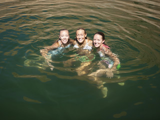 """USA, Utah, Lake Powell, Three women swimming in lake"""