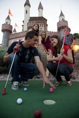 """USA, Utah, Orem, Parents and kids (10-17) playing golf"""