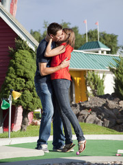 """USA, Utah, Orem, Couple kissing on golf course"""