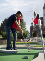 """USA, Utah, Orem, Couple playing golf"""
