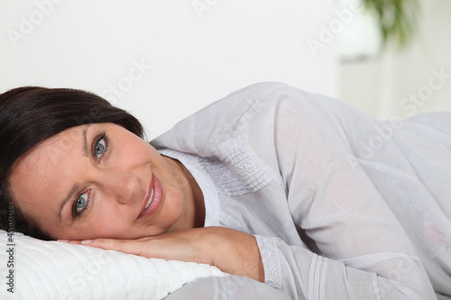 Woman laying on cushion