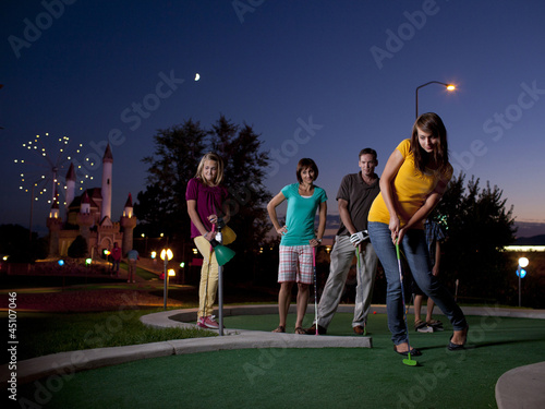 """USA, Utah, Orem, Parents and kids (10-17) playing golf"""