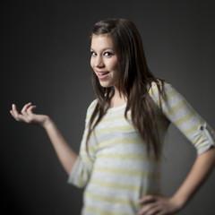 Studio portrait of teenage girl (14-15) with hand on hip